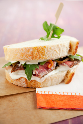Prime Rib Sandwich with Caramelized Onions, Arugula and Horseradish Cream Thumbnail